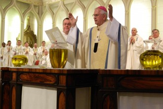 Archbishop Joseph E. Kurtz consecrated the chrism during the annual Chrism Mass April 3 at the Cathedral of the Assumption. He was assisted by seminarian Peter Bucalo.