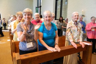 Sisters of Loretto and Loretto co-members applauded at a special liturgy in 2012 to mark their bicentennial. Women religious in the area have been at the forefront of efforts to care for creation in the Archdiocese of Louisville. Record Photo by Marnie McAllister