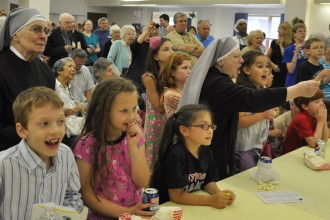 Enthusiastic crowds cheered on their favorite at the Little Sisters of the Poor annual Turtle Derby.
