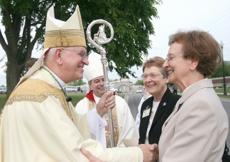 Archbishop Joseph E. Kurtz, left, greeted, from left, Ursuline Sisters of Mount St. Joseph Amelia Stenger and Susan Mary Mudd on April 29 in front of the David R. Hourigan Government Building in Marion Co., Ky. Bishop William Medley of Owensboro stood in the background. Last weekend, the Ursuline Sisters of Mount St. Joseph celebrated their centennial in Marion County, where the sisters served in education. (Photos by Stephen Lega, The Lebanon Enterprise)