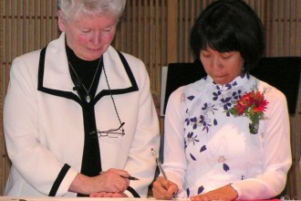 Sr. Mary Vuong, right, signed her vows as a Dominican Sister of Peace, while Sr. Margaret Ormond, Prioress, witnessed. (Photo Special to The Record)