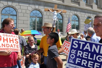 Hundreds of people gathered outside the Gene Snyder U.S. Courthouse, 601 West Broadway, for a religious freedom rally June 8. The rally was organized by the St. Louis Bertrand Council of the Knights of Columbus. (Record Photos by Jessica Able)