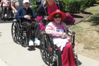 Residents of Mercy Sacred Heart Village were escorted by staff and volunteers down the street to the Comfy Cow ice cream parlor June 27. (Photo Special to The Record)