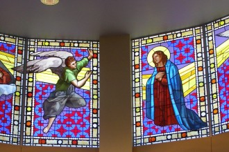 """The new stained glass windows at the Church of the Annunciation in Shelbyville, Ky., were designed, fabricated and installed by Kenneth von Roenn Jr., owner and principal designer of Architectural Glass Art, Inc. In addition to the four windows shown above, four additional panels display the """"litany"""" of the Blessed Virgin. (Record Photo by Glenn Rutherford)"""