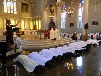 The deacons laid prostrate before the altar of the Cathedral of the Assumption during the Litany of Supplication at their Aug. 25 ordination.