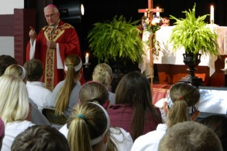 Archbishop Joseph E. Kurtz celebrated the feast of the Exaltation of the Holy Cross today, Sept. 14, at Holy Cross High School. He urged students to seek to know God's plan for their lives and to learn, with God's aid, to love others selflessly.