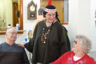 Ann Harris, a parishioner at Good Shepherd Church, dressed as St. Kateri Tekakwitha, for a Nov. 4 presentation on saints at the parish in the Portland neighborhood. Talking with Harris are Norma Higgins, a former parishioner of the old Church of Our Lady, and Jim Higgins, who was a parishioner at St. Cecilia Church. Those two parishes, along with St. Anthony Church, were merged to form Good Shepherd Church in 2009. (Photo by Ruby Thomas, Special to The Record)