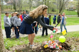 St. James School sixth-grader Natalie Copeland laid a paper chain on a redbud tree for Sandy Hook students. (Record Photos by Marnie McAllister)