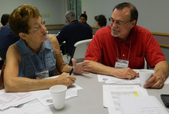 Rosemary Smith, left, and Larry Howe-Kerr, both members of the Church of the Epiphany, discussed the struggles immigrants face in the United States during a program in Elizabethtown, Ky., May 16. (Photo by Marnie McAllister)