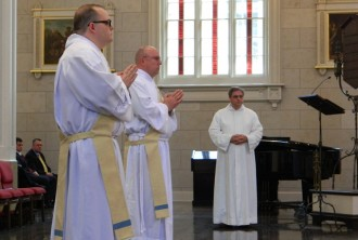 Father Brown, left, and Father Lubecke, center. (Record Photos by Marnie McAllister)