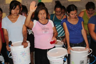 Honduran women, below, prayed and offered thanks to God during their training to use the systems. Photo Special to The Record