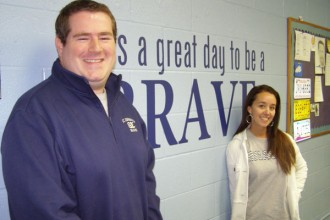 Andrew Bradley, principal of St. Edward School, and Selena Jones, the schools director of recruitment and development, paused in Bradley's office Oct. 19 before they and the rest of the school's teaching staff began a door-to-door campaign to tell people about their school and announce a $1,500 tuition grant for new students entering the school in the fall of 2014. (Record Photo by Glenn Rutherford)