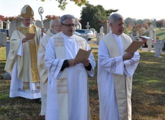 Archbishop Joseph E. Kurtz, left, celebrated All Souls' Day Mass Nov. 2.
