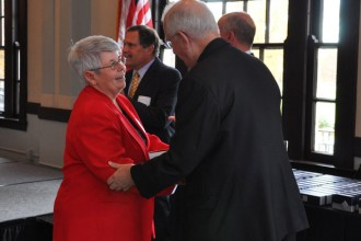 Presentation Academy teacher Dr. Debbie Hall, left, accepts her Catholic Education Foundation Teacher Award from Archbishop Joseph E. Kurtz. Hall was one of nine high school educators who received the teaching award, which is sponsored by the Dan Ulmer Family.