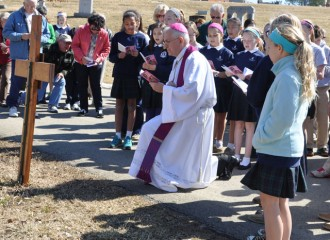 Archbishop Joseph E. Kurtz led the Stations of the Cross with students from St. Agnes School at Calvary Cemetery March 7.
