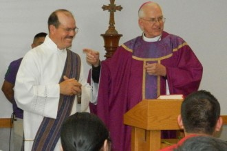 Archbishop Joseph E. Kurtz gestures to Deacon Aurelio Puga during the fifth annual Hispanic Day of Reflection held April 5 at the Maloney Center. About 60 people attended the event. (Photo Special to The Record by Ruby Thomas)