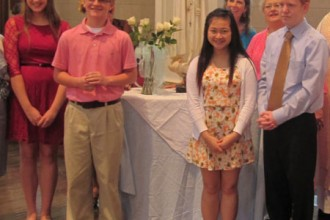 Eighth-grade students who received high school scholarships from the Queen's Daughters were recognized at the Cathedral of the Assumption May 13. They are, from left, Haysley Kelty, Matthew Clemons, Gloria Fan and Phillip Thornberry. (Photo Special to The Record)