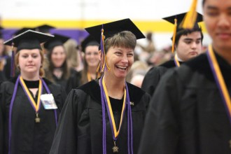Christina Vaughn, center, was all smiles as she entered St. Catharine College's commencement ceremony on May 10. The college conferred 175 degrees, the most in the Springfield, Ky., school's history. (Photo Special to The Record by Jesse Osbourne)