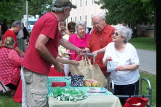 Residents lined up for food and information during the Aug. 15 celebration of the 35th anniversary of the Sisters of Charity of Nazareth housing ministry in Nazareth, Ky. (Photo Special to The Record by Amy Taylor)