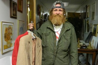 Ricky Thompson, a formerly homeless veteran who lived at St. Thomas More Church for about year, helped hang clothes at the parish's Twice Blessed Thrift Store early last month. (Record Photo by Marnie McAllister)