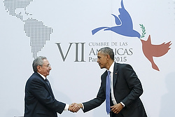 Obama shakes hands with Castro as they hold bilateral meeting during Summit of the Americas in Panama City