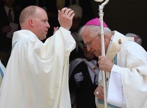 Father Shayne Duvall gave Archbishop Kurtz his first blessing. (Record Photo by Jennifer Jenkins)