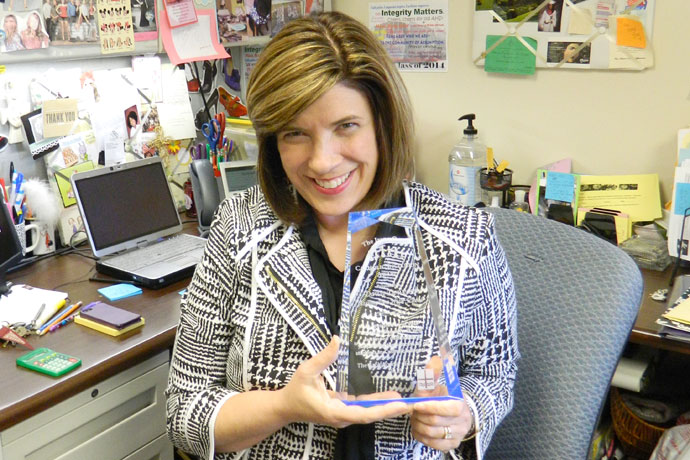 Dawn Deweese, guidance program director at Assumption High School, 2170 Tyler Lane, is pictured in her office, where she stores resources for her students in need. Deweese received the 2015 Irene Casey Catholic Inclusion Award from the Archdiocese of Louisville on Aug. 14. Record Photo by Ruby Thomas