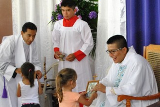Two little girls presented gifts from the Archdiocese of Louisville during the inaugural Mass celebrated at John Paul II Church in Cana Brava, Nicaragua, in March. The building of the church was made possible by donations from five parishes and two Knights of Columbus councils.