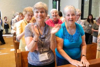 Sisters of Loretto and Loretto co-members applauded at a special liturgy in 2012 to mark their bicentennial. Women religious in the area have been at the forefront of efforts to care for creation in the Archdiocese of Louisville. Record Photo File by Marnie McAllister