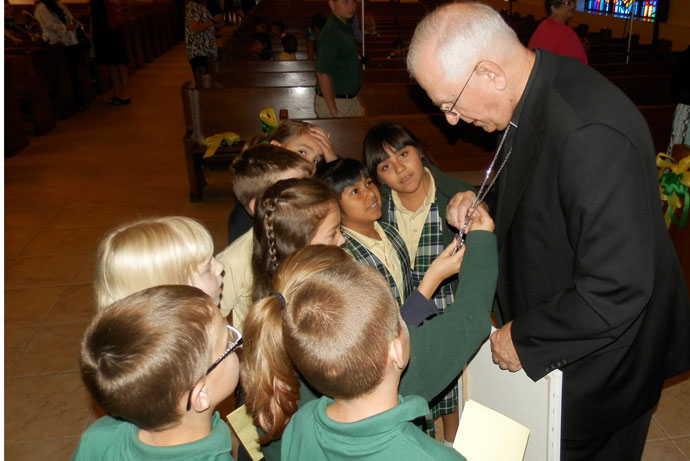 A group of kids stopped to chat with Archbishop Joseph E. Kurtz following an assembly Aug. 25 at St. Rita School in Okolona. Record Photo by Ruby Thomas