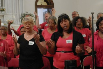 Members of the choir sang The Lord's Prayer during an opening Mass for the 32nd annual African American Catholic Day of Reflection Sept. 12 at St. Martin de Porres Church, 3112 W. Broadway. The day continued with workshops next door at the Catholic Enrichment Center, 3146 W. Broadway. (Record Photo by Ruby Thomas)