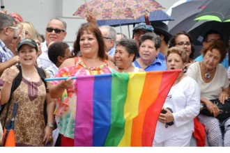 A crowd gathers for a massive same-sex wedding in San Juan, Puerto Rico, Aug. 16. Sixty-four of the 73 same-sex couples scheduled to take vows attended the event. CNS photo/Wallice J. de la Vega