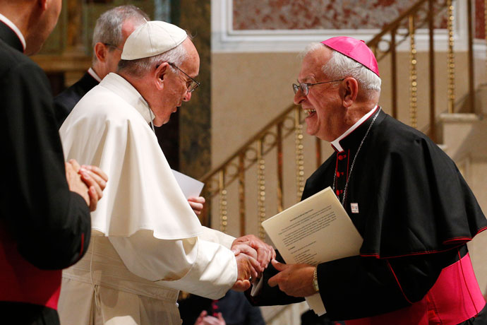 Pope Francis greets Archbishop Joseph E. Kurtz of Louisville, Ky., president of the U.S. Conference of Catholic Bishops, during a meeting with U.S. bishops in the Cathedral of St. Matthew the Apostle in Washington Sept. 23. (CNS photo/Paul Haring)