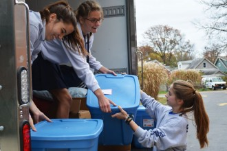 Sacred Heart Academy students loaded toys to be delivered to children and families in Kermit, W.Va. Photo Special to The Record