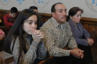 """Several Hispanic families, such as the one above, took part in a """"Unity"""" Mass at St. Joseph Church in Butchertown Nov. 15 to celebrate the parish's 150th anniversary. The Mass was celebrated in English and Spanish and was followed by a brunch. The Mass was one of three events planned to celebrate the church's anniversary which will take place next year. Record Photo by Ruby Thomas"""