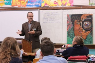 Marc Bouchard of Catholic Charities spoke to St. Catherine Academy students about the work of the Migration and Refugee Services.