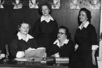 Mary Miller, left, was among the first lay teachers at St. George School. She is pictured in 1959 with other lay teachers, from left, Patricia O'Leary, Mrs. William Ralston and Mrs. Martin Rosenberger, wearing uniforms they designed. At age 100, Miller looks back on her life as a teacher, mother and wife. (Record file photo)