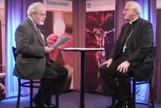 Archbishop Joseph E. Kurtz, right, and Dr. Brian Reynolds are pictured on the set of 'Conversations,' the archbishop's monthly TV show.