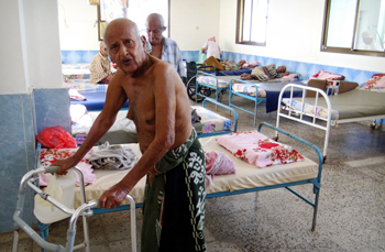 Survivors of an attack are seen at a room for elderly care March 4 after unidentified gunmen targeted the home in Aden, Yemen, March 4. (CNS photo)