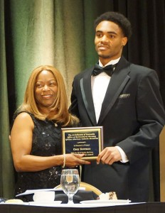 Cory Bowman, left, was photographed with M. Annette Mandley-Turner. He received one of the Rodriq McCravy Awards for college students. (Record Photo by Ruby Thomas)