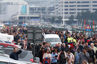 People evacuate Zaventem airport after explosions near Brussels March 22. (CNS photo/Laurent Dubrule, EPA)