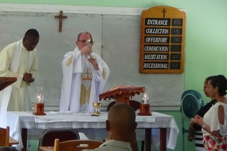 Father J. Ronald Knott celebrated Mass in the Diocese of Kingstown, St. Vincent and the Grenadines, on April 3. The Catholic community of Corpus Christi gathers for Mass in a classroom at St. Vincent and the Grenadines Community College because it lacks a church. (Photo Special to The Record)