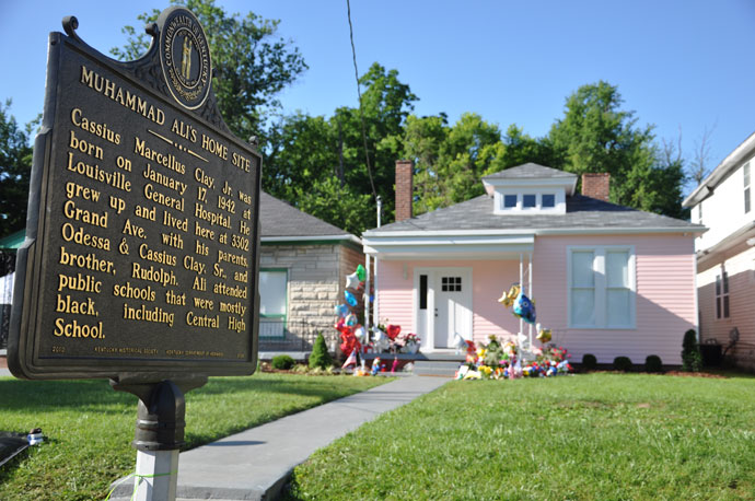 Memorials honoring the late Muhammad Ali stand in front of the boyhood home of the three-time heavyweight champion. The house, located at 3302 Grand Avenue, was recently restored and it opened to the public for tours on May 28. (Record Photo by Jessica Able)