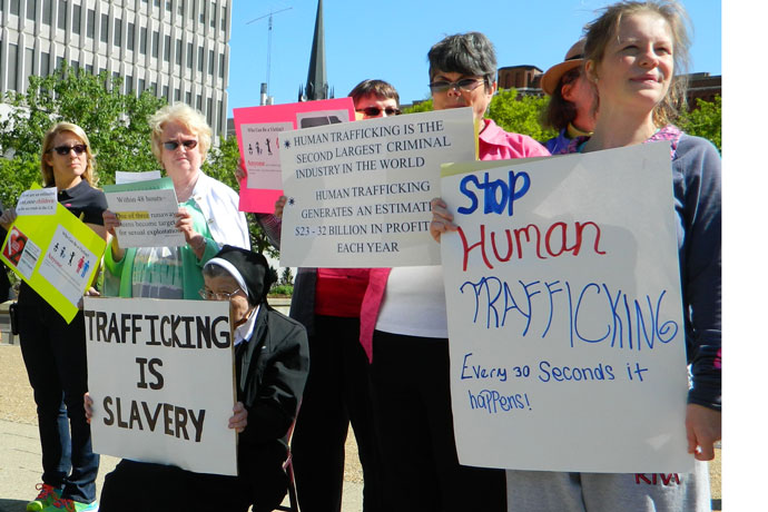 Record File Photo by Marnie McAllister  Women religious and lay people held signs condemning human trafficking during a prayer service in 2015. A new program at Catholic Charities aims to curb trafficking of young people and offers an opportunity to practice a spiritual work of mercy, comforting the sorrowful.