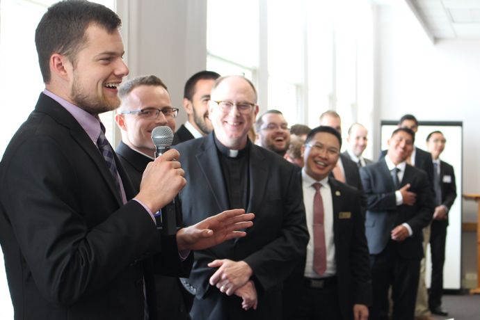 Seminarian David Ferrell discussed his summer assignment as his fellow seminarians looked on during an annual luncheon sponsored by Serra Club on Aug. 11.