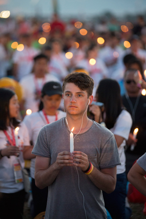 World Youth Day pilgrims hold candles during eucharistic adoration with Pope Francis at the July 30 prayer vigil at the Field of Mercy in Krakow, Poland. (CNS photo/Jaclyn Lippelmann, Catholic Standard)