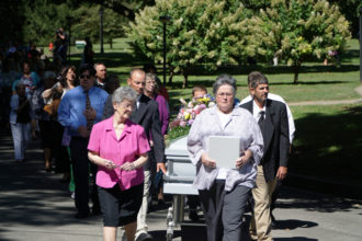 Mourners processed from the St. Vincent Church in Nazareth, Ky., to Nazareth Cemetery following the Funeral Mass of Sister of Charity of Nazareth Paula Merrill. (Record Photo by Marnie McAllister)