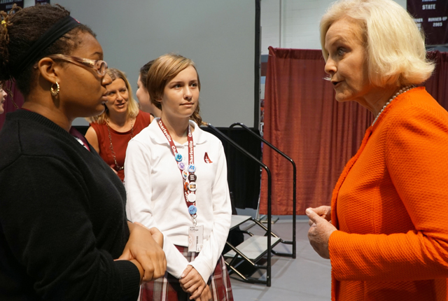 Cindy McCain, right, spoke to Assumption High School students, from left, Marjani Lawson and Anna Korfhage, after a school-wide assembly Sept. 16. McCain told the student body about the problem of human trafficking, cautioning her listeners to be careful and urging them to report suspicious behavior. (Record Photo by Marnie McAllister)