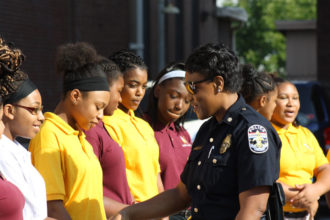 """Photos Special to The Record  Salute to first responders  Major Andrea Brown, a first division commander with the Louisville Metro Police Department, spoke with Nalani Hamblin, an eighth-grader at Nativity Academy at St. Boniface. Nativity Academy held a """"Salute to First Responders"""" Sept. 14 at the school on East Liberty Street. Students offered gifts of appreciation and served refreshments to Louisville police officers, fire fighters and emergency medical technicians, according to a news release from the school."""
