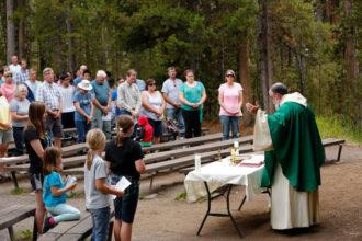 Jesuit Father Rick Malloy celebrates Sunday vigil Mass in Yellowstone National Park in Wyoming Aug. 6. (CNS photo/Nancy Wiechec)